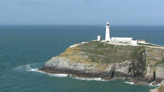 Zoom out from South Stack Lighthouse on Holy Island, Anglesey Stock Footage