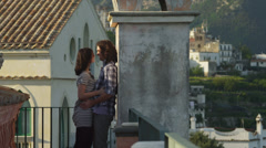 Stock Video Footage of MS Young couple flirting on terrace / Ravello,Italy