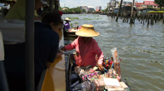Selling goods on a river in Bankok Thailand Stock Footage