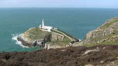 Irish sea and the South Stack Lighthouse, Holyhead, Holy Island Anglesey Stock Footage