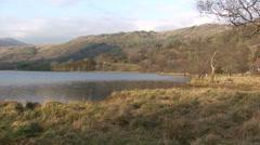 Pan left on Llyn Gwynant lake in Snowdonia Stock Footage