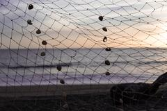 Fishing net in beach at sunshine Stock Photos