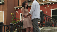 SLO MO MS Young couple kissing footbridge / Venice,Italy Stock Footage