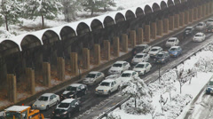 The cars stuck in snow due to a blizzard in Jerusalem Stock Footage