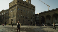 WS TU Pedestrians walking on square in front of Palazzo Vecchio / - stock footage
