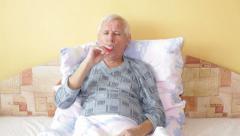 Senior man with asthma inhaler Stock Footage