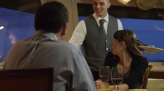 MS TU Waiter serving couple their meals in restaurant / Petriolo,Marche,Italy Stock Footage