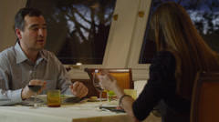 MS Couple feeding each other in restaurant / Petriolo,Marche,Italy Stock Footage