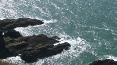 Waves crashing against coastal rocks by the cliff in Holy Island Anglesey Stock Footage