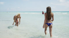 WS Two women playing in surf / South Beach, Miami, Florida, USA Stock Footage