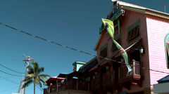Cayman Islands, big colored restaurant in the shore street from below Stock Footage