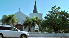 Cayman Islands, the chapel in the shore street with driving cars in foreground Stock Footage