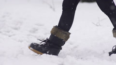Slow-Mo: Female Black Snow Boots Walking Through Fresh Snow - stock footage