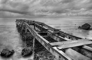 Stock Photo of rusty old pier in a cloudy day