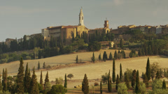 Wide shot of church in Italian hillside town / Piensa, Tuscany, Italy Stock Footage