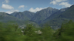 Tracking shot through Italian countryside with mountains in background / , Italy - stock footage