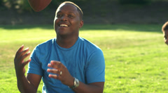 Stock Video Footage of A father rest as he was plays football with his kids