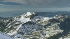 Wide shot/high angle of snow covered mountain / Schilthorn Piz Gloria, Bern, Stock Footage