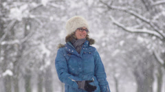Slow-Mo: Young Woman Walking Through Winter Tree Avenue Stock Footage