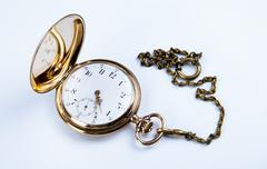 gold pocket watch on white - stock photo