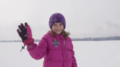 Slow-Mo: Little Girl Waves And Runs Over Snow Covered Field Stock Footage