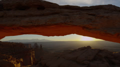 Wide shot, time lapse of sun rising over Mesa Arch, Canyonlands National Park / - stock footage
