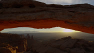 Stock Video Footage of Wide shot, time lapse of sun rising over Mesa Arch, Canyonlands National Park /