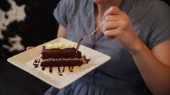 Shaky tracking shot of woman eating cake in restaurant / Orem, Utah, United Stock Footage