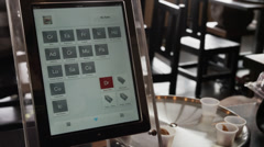 Close up of woman using digital tablet ordering system in restaurant / Orem, Stock Footage