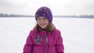 Stock Video Footage of Slow-Mo: Girl Blows Her Nose On Snow Covered Field