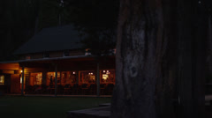 Panning wide shot of cabin at night / Redfish Lake, Idaho, United States - stock footage