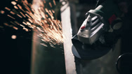 Stock Video Footage of Manual sharpening. Sparks fly from metal grinder
