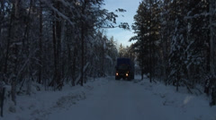 Trucks on the winter road in the taiga Stock Footage