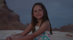 Close up of smiling girl on beach at night / Lake Powell, Utah, United States Stock Footage
