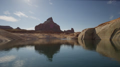 Wide shot of rock formation and lake / Lake Powell, Utah, United States Stock Footage
