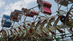 Panning low angle shot of spinning amusement park ride / American Fork, Utah, Stock Footage