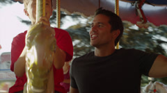 Close up of father and son riding carousel at carnival / American Fork, Utah, Stock Footage