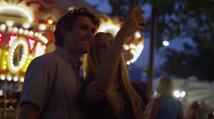 Close up panning shot of young couple taking selfie at carnival / American Fork, Stock Footage