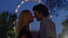 Close up of young couple kissing at carnival / American Fork, Utah, United Stock Footage