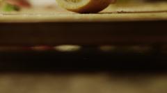 Panning close up of woman slicing lemon / Cedar Hills, Utah, United States Stock Footage