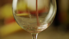 Panning close up of red wine pouring into wine glass / Utah, United States - stock footage