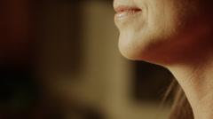 Panning close up of woman biting into cucumber slice / Cedar Hills, Utah, United - stock footage