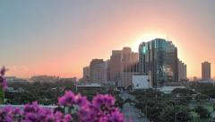 4k, UHD, Golden sunset through Honolulu cityscape, tracking, HDR time lapse Stock Footage