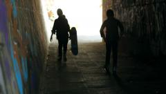 Three Friends Boys with Skate Silhouettes in Graffiti Tunnel Underground HD Stock Footage