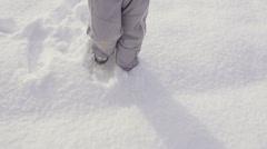 Slow-Mo: Child's Legs Walking Through Fresh Snow Stock Footage