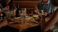 Close up of family eating dinner in restaurant / Idaho, United States Stock Footage