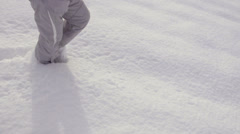 Slow-Mo: Girl's Legs Trudging Through Snow Covered Field Stock Footage