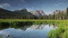 Panning wide shot of mountains and calm lake / Redfish Lake, Idaho, United - stock footage