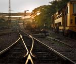 Cargo train platform at sunrise Stock Photos