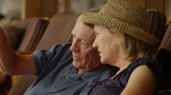 Close up of senior couple talking on lounge chairs / Idaho, United States Stock Footage